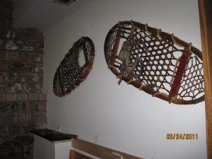 Wood snowshoes with leather bindings and mesh