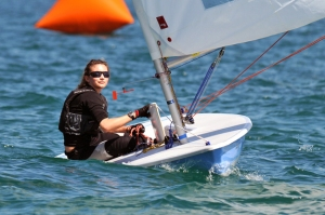 Woman sailing laser dingy