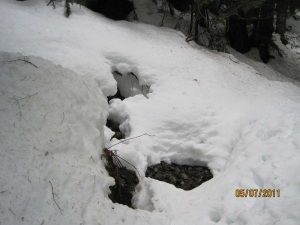 snow undermined by streams