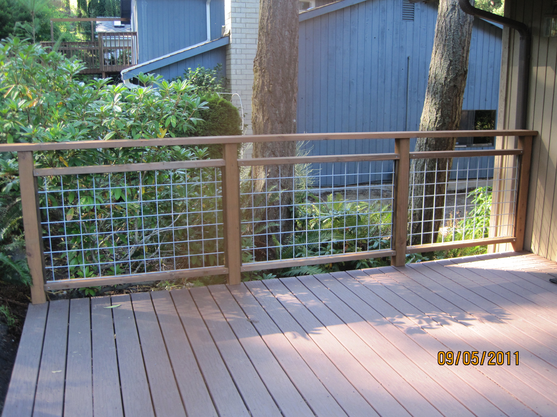 Do it yourself deck railing is done hamster dreams for How to build an inexpensive deck